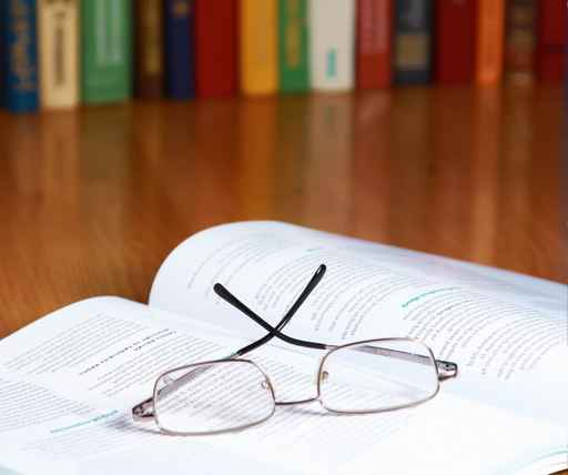 book with glasses on the desk
