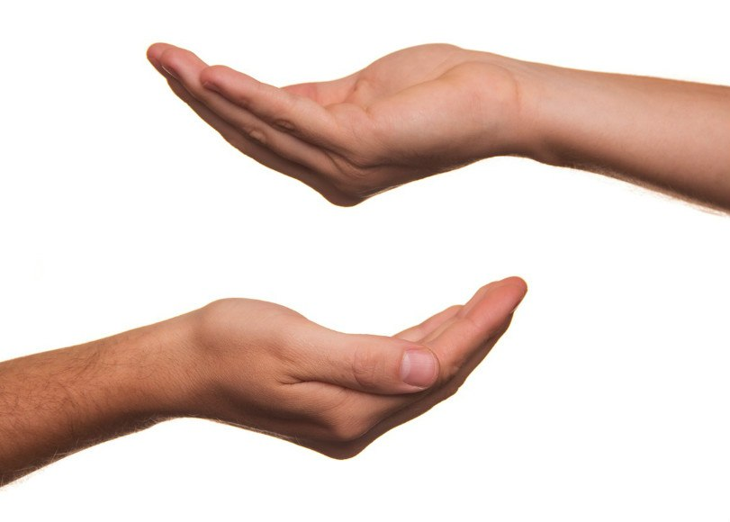 two-hands-reaching-out-on-white-background