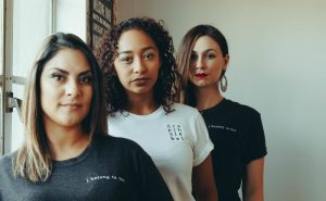 three-diverse-women-looking-at-camera