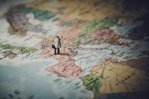 person-figurine-on-map-of-mediterranean
