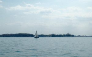 sailboat-on-water-cloudy-sky